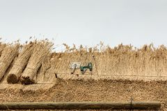 Thatched Roof with Straw and tools Royalty Free Stock Photography