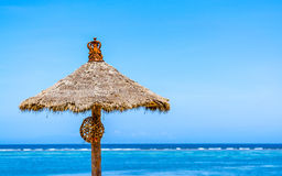 Thatched roof sun shade on a beautiful sunny day Stock Image
