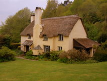 Cottage with thatched roof. A typical thatched cottage in the county of Somerset in England Royalty Free Stock Images