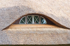 Thatched roof window Stock Photo