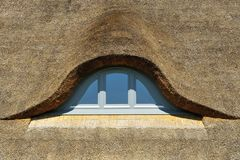 Thatched roof with window Royalty Free Stock Photo