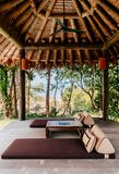 Thatched roof wood pavillion tropical island resort with Thai st royalty free stock images