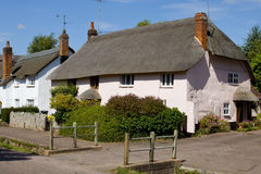 Thatched Roofed Cottage. An English cottage with a thatched roof royalty free stock photo