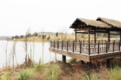 A thatched shed sightseeing stand by the lake.  Royalty Free Stock Photos