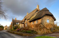 Thatched stone cottage, England. Cotwold thatched stone cottage, Ebrington, Gloucestershire, England Royalty Free Stock Photos