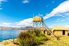Thatched tower on Floating  Islands on Lake Titicaca, Peru, South America. Royalty Free Stock Image
