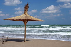Seascape. Thatched umbrella. Summer, sea, sun, holiday, waves, fun, beach - Black Sea, landmark attraction in Romania Royalty Free Stock Photography
