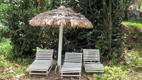 Thatched Umbrella and Chairs Royalty Free Stock Photography