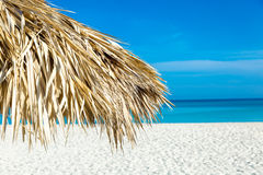 Thatched umbrella at the famous Varadero beach in Cuba on a beautiful summer day.  Stock Image
