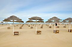 Thatched umbrellas Stock Images