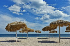 Thatched umbrellas Royalty Free Stock Photos