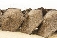 Thatched umbrellas on the beach Royalty Free Stock Photo
