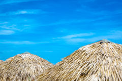 Thatched umbrellas at the famous Varadero beach in Cuba on a beautiful summer day Royalty Free Stock Images