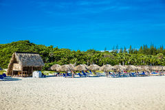 Thatched umbrellas at the famous Varadero beach in Cuba on a beautiful summer day Royalty Free Stock Photo