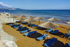Thatched umbrellas on the xsi beach, Kefalonia, Greece Stock Photography