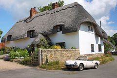 Thatched Village Cottage Stock Image