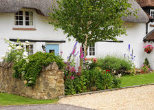 Thatched Village Cottage Stock Photo