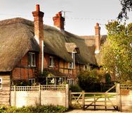 Thatched Village House. Quaint Thatched Village House in a Rural English Village Stock Photos