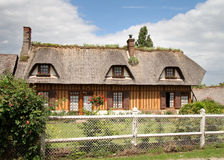 Thatched Village House in Normandy France. Traditional Timber Framed thatched Village House and garden in Normandy, France Royalty Free Stock Image