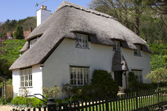 Thatched white cottage. On sunny day Royalty Free Stock Image