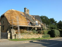 Thatching a country cottage. The traditional british craft of thatching a cotswolds country cottage Royalty Free Stock Photos