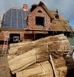 Thatching a Roof on Foehr Island. Foehr or Föhr is one of the North Frisian Islands on the German North Sea coast. It is located in the federal state of Stock Photography
