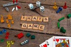`Thats Game` made from Scrabble game letters. Risk, Battleship pieces, Monopoly, Settler of Catan and other game pieces royalty free stock photography