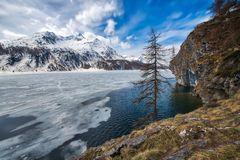 Thaw in the Engadine valley near the Maloja pass.  Royalty Free Stock Image