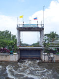 Thawi Watthana floodgate. Opening to relieve pressure from flooding, Bangkok, Thailand Stock Photos