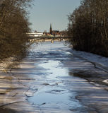 Thawing River with Distant Church Royalty Free Stock Photo