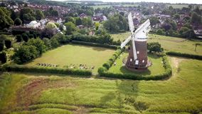 Thaxted village and windmill, Essex, England. 4k aerial drone video footage reversing from the prominent windmill landmark overlooking the village of Thaxted in stock video footage