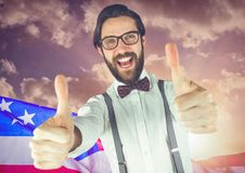 ThBusiness man with thumbs up against american flag Stock Images