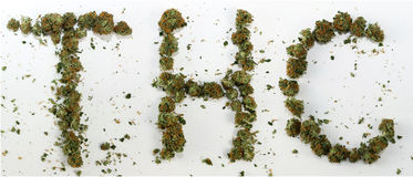 THC Spelled With Marijuana. The word THC spelled out with real marijuana royalty free stock photos