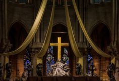 The Altar And The Cross Of The Notre Dame De Paris Cathedral With The Stained Glass Windows Along The Back Wall In Paris France Stock Images