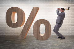 Free The Angry Man With Axe Axing The Percentage Sign Stock Photo - 87484930