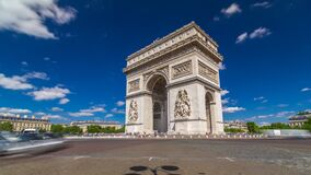 Free The Arc De Triomphe Triumphal Arch Of The Star Timelapse Is One Of The Most Famous Monuments In Paris Royalty Free Stock Image - 217516786