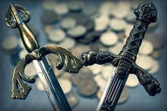 Free The Arms Of Ancient Knightly Swords On The Background Of A Scattering Of Coins. Stock Photography - 190287172
