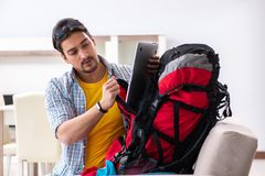 The Backpacker Packing For His Trip Royalty Free Stock Image