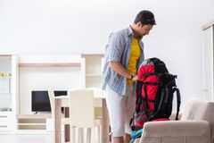 The Backpacker Packing For His Trip Royalty Free Stock Photography