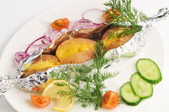 The Baked Potato In A Foil With A Garnish Royalty Free Stock Photography