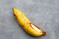 Free The Bananas Is Medium Ripe With Brown Spots All Over The Yellow Skin. Stock Photos - 221350003