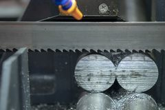 Free The Band Saw Machine Cutting Raw Metals Rods. Royalty Free Stock Image - 130295446