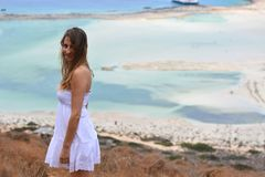 Free The Beautiful Girl In The Happy White Dress On Vacation Stock Image - 148001161