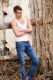 The Beautiful Man Against Brick Wall Stock Photo