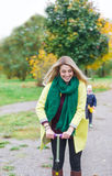 The Beautiful Woman On The Scooter In The Autumn Park. Royalty Free Stock Photography