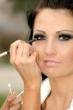 The Beautiful Woman Put Make-up Royalty Free Stock Image