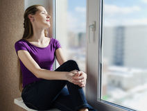 The Beautiful Woman Sits Near A Window Stock Photos