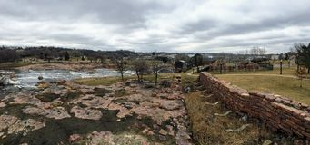 Free The Big Sioux River Flows Over Rocks In Sioux Falls South Dakota With Views Of Wildlife, Ruins, Park Paths, Train Track Bridge, Tr Royalty Free Stock Photo - 113901495