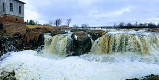 Free The Big Sioux River Flows Over Rocks In Sioux Falls South Dakota With Views Of Wildlife, Ruins, Park Paths, Train Track Bridge, Tr Royalty Free Stock Images - 113901509