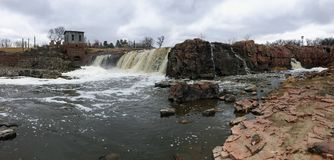 Free The Big Sioux River Flows Over Rocks In Sioux Falls South Dakota With Views Of Wildlife, Ruins, Park Paths, Train Track Bridge, Tr Royalty Free Stock Photography - 113901527